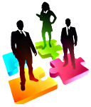 Silhouettes of business people standing on multi-colored puzzle pieces