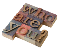 "Woodcut blocks with the words ""who are you?"""