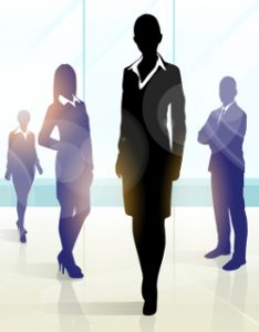 A photo of the silhouettes of business people