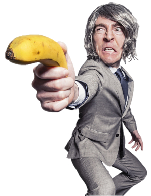 Photo of a wild-eyed man in a gray suit wielding a banana like a gun