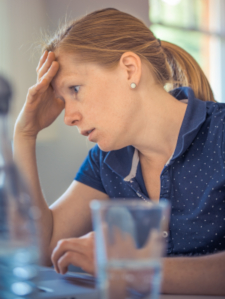 Photo of stressed-out woman in an office setting