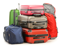 Photo of assorted suitcases and duffels on a white background