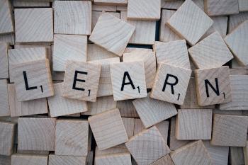 Scrabble letters spelling LEARN