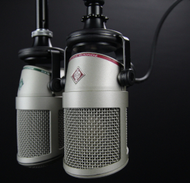 Black-and-white photo of professional microphones