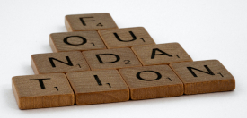 Photo of Scrabble letters spelling out FOUNDATION