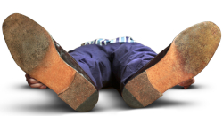 Photo of a person lying down, ground level, feet first